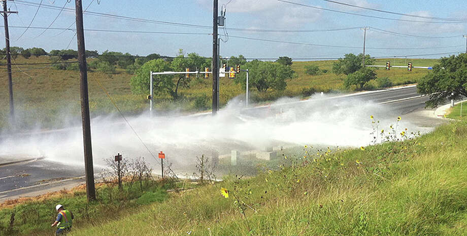 A water main that supplies Rolling Oaks Mall and a nearby neighborhood ruptured early Sunday, causing water to spew into the far Northeast Side street.