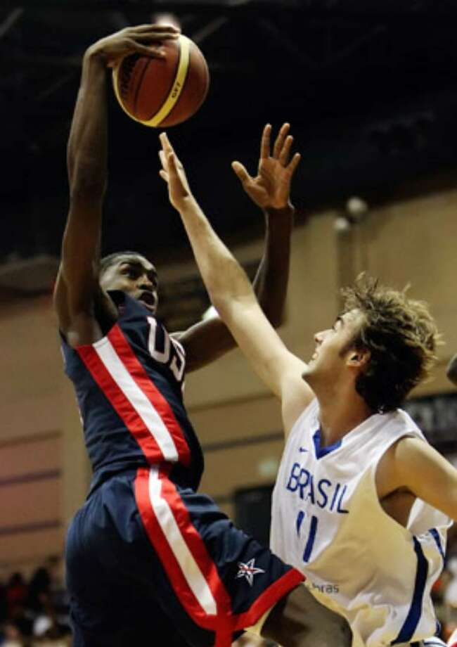 Team USA's Jereme Richmond soars past Brazil's Gabriel Aguirre during the FIBA Americas U18 gold-medal game.