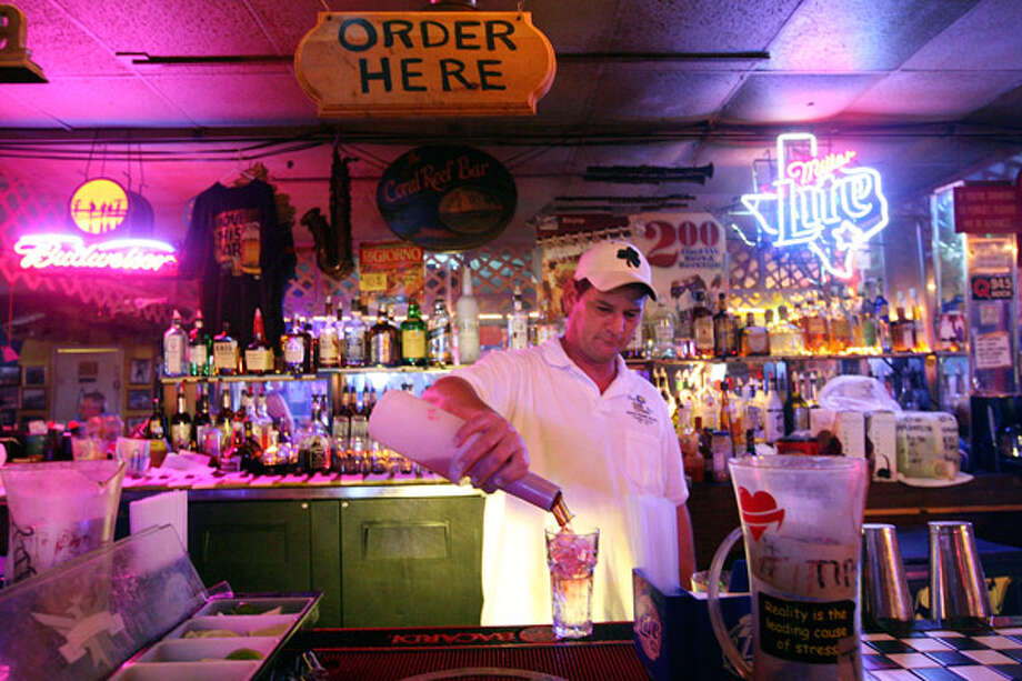 Coral Reef Sports Bar Manager Bill Weidner mixes a drink for a customer. Unlike most places on South Padre Island, his business booms during hurricanes.