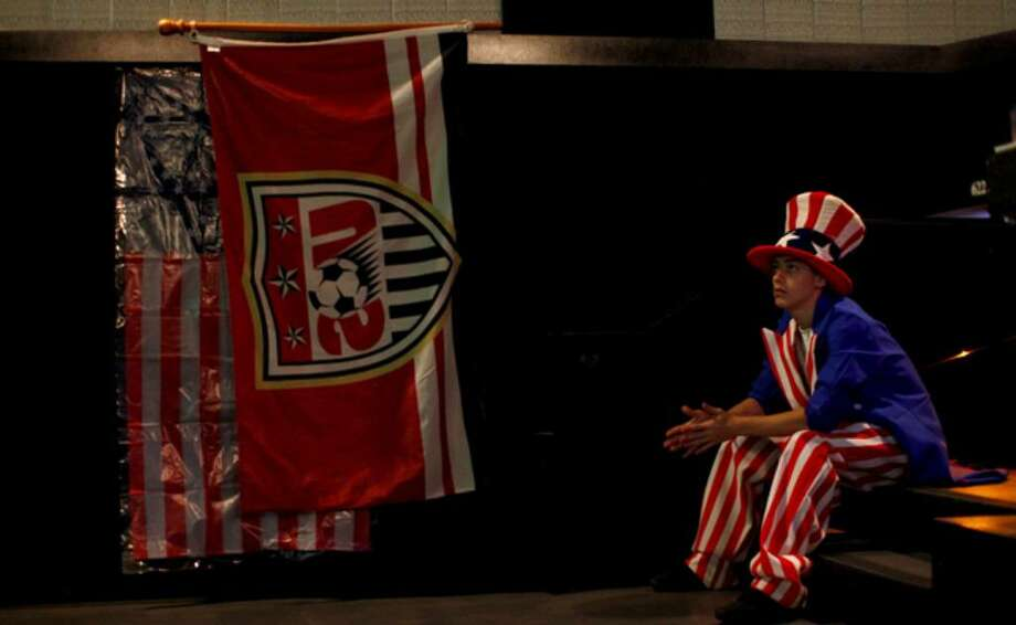 Daniel Suarez, 17, a member of the Crocketteers, a local soccer supporters group, watches the U.S.-Ghana World Cup match during a party at Alamo Drafthouse Cinema Park North.