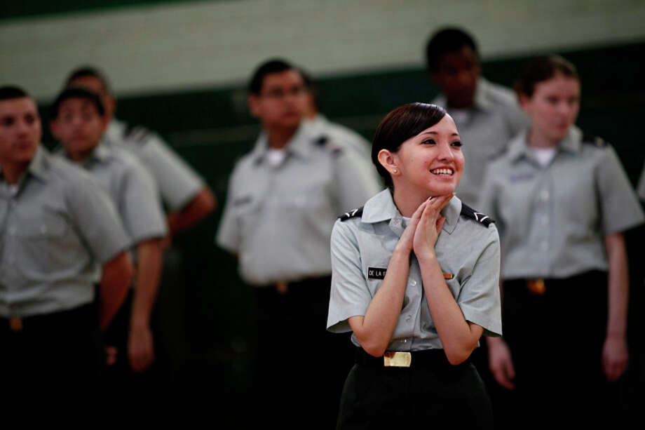 Sophomore Allison De La Fuentes stands with fellow Sam Houston JROTC cadets during the Army formal inspection process at Sam Houston High School on Monday, Jan. 25, 2010. / SAN ANTONIO EXPRESS-NEWS