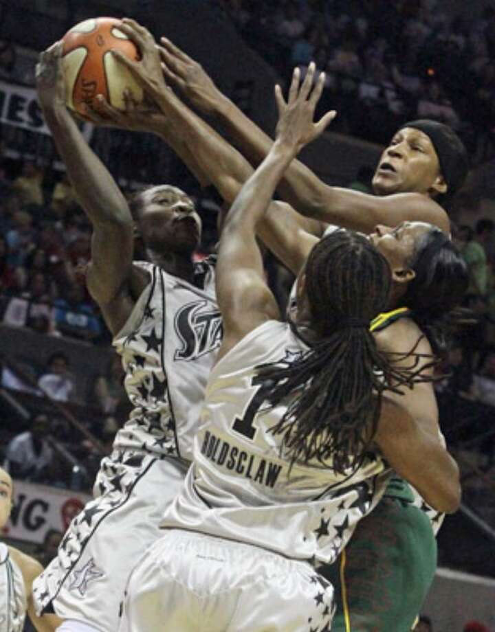 The Silver Stars' Sophia Young (left) wrestles a rebound away from Seattle's Tanisha Wright in Tuesday's loss.