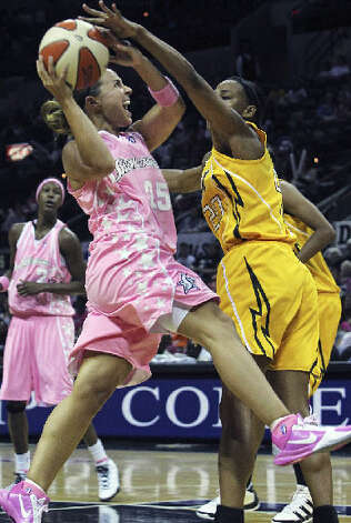 Silver Stars guard Becky Hammon drives past Tulsa?s Marion Jones at the AT&T Center on Friday. Hammon had 15 points, eight assists and four rebounds.