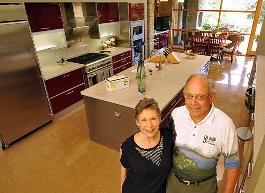 Nancy and Steve Sherman enjoy their open kitchen. / Copyright 2010 by Robin Jerstad, JerstadPhotographics LLC, All rights reserved. www.JerstadPhoto.com