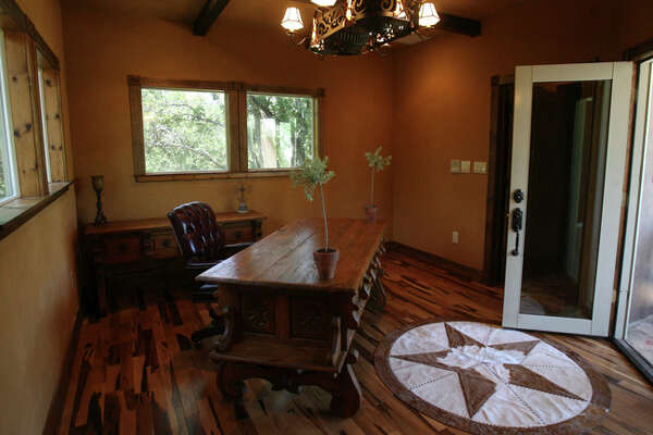 An office space is on the second story of a guesthouse in the back of the Rockwall Ranch home of Christine Barker.