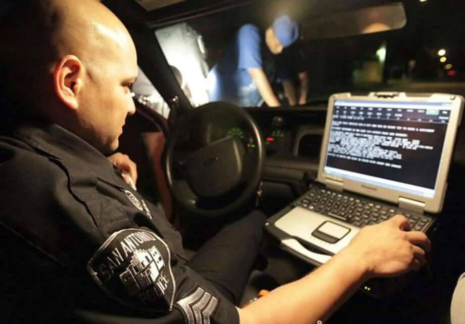 Sgt. Tom Alonzo checks on an individual's background from his in-car computer during a recent stop as part of the SAPD's new Problem Oriented Policing (POP) unit.