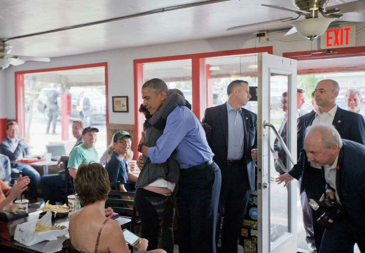 President Barack Obama is hugged by a patron during his unannounced stop at Torchy's Tacos, Friday, March 11, 2016, in Austin, Texas. Obama traveled to Austin, to speak at South by Southwest Festival (SXSW) and attend 2 Democratic National Committee fundraisers.