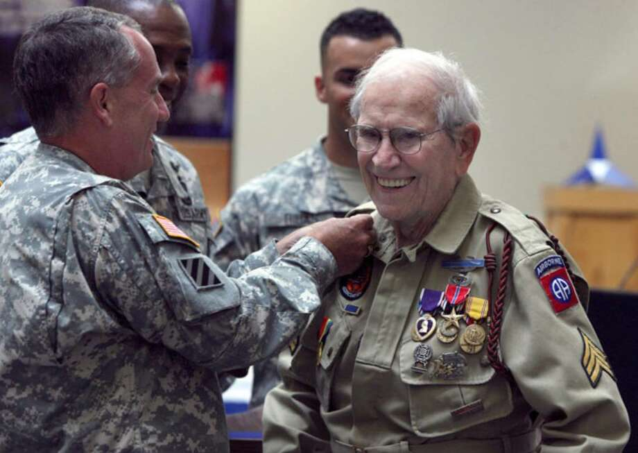Maj. Gen. William Grimsley decorates World War II veteran Bob Bearden, 87, at a ceremony Monday at Fort Hood.  The former Army sergeant received his 13 medals and badges, including a Bronze Star and Purple Heart, 65 years after the end of the war.