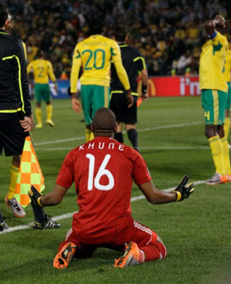 South Africa goalkeeper Itumeleng Khune reacts after being given a red card by Swiss referee Massimo Busacca (in the background) during the World Cup group A soccer match between South Africa and Uruguay at the Loftus Versfeld Stadium in Pretoria, South Africa, on Wednesday, June 16, 2010.