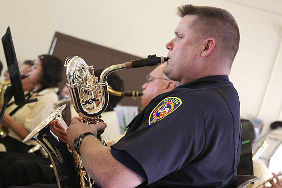 Lt. Mike Parsons, who is a Helotes firefighter, manned the baritone sax for the Helotes Community Band's celebration performance at the dedication of the new fire and police stations. While the rest of the band wore yellow shirts, Parsons proudly played in his HFD uniform.