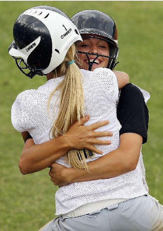 Seguin?s Alex Bothe (white jersey) celebrates with teammate Brooke Abrameit after Bothe scored against Edison during Seguin?s victory.