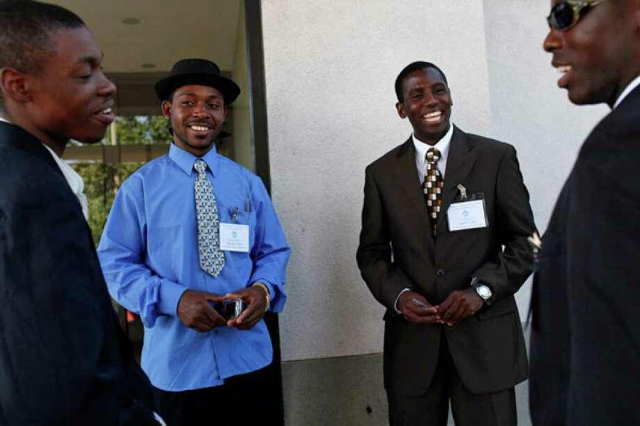 Mohamed Muse (from left) and Hamadi Shebule of Buffalo, N.Y., talk with Dadiri Jama and Issak Issak of San Antonio.