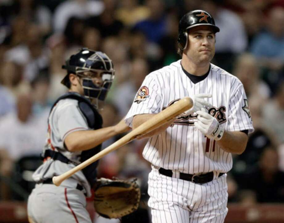 Lance Berkman tosses his bat after a strikeout Tuesday. Oddly enough, Houston is No. 4 in fewest Ks.