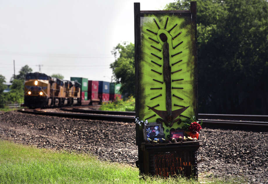 The memorial shrine built by Elizabeth Rodriguez near Ceralvo and Driftwood streets, where she was injured and two friends were killed after their car was hit by a train. / rowen@express-news.net