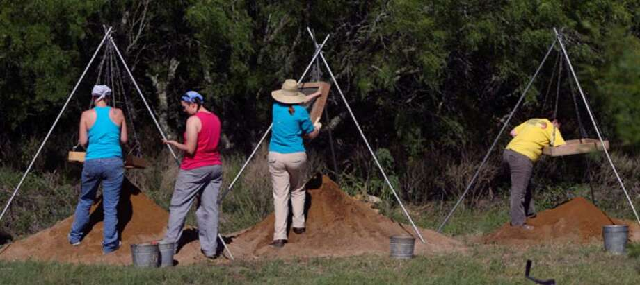 Students and volunteers with UTSA's Center for Archaeological Research sift through dirt for artifacts at the site of the Rancho de las Cabras.