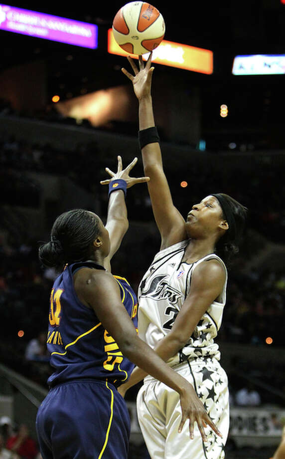 The San Antonio Silver Stars' Michelle Snow (02) shoots over Connecticut Suns' Tina Charles (31) in the first half at the AT&T Center on Tuesday, July 6, 2010. The 'Stars defeated the Sun, 79-66. / San Antonio Express-News