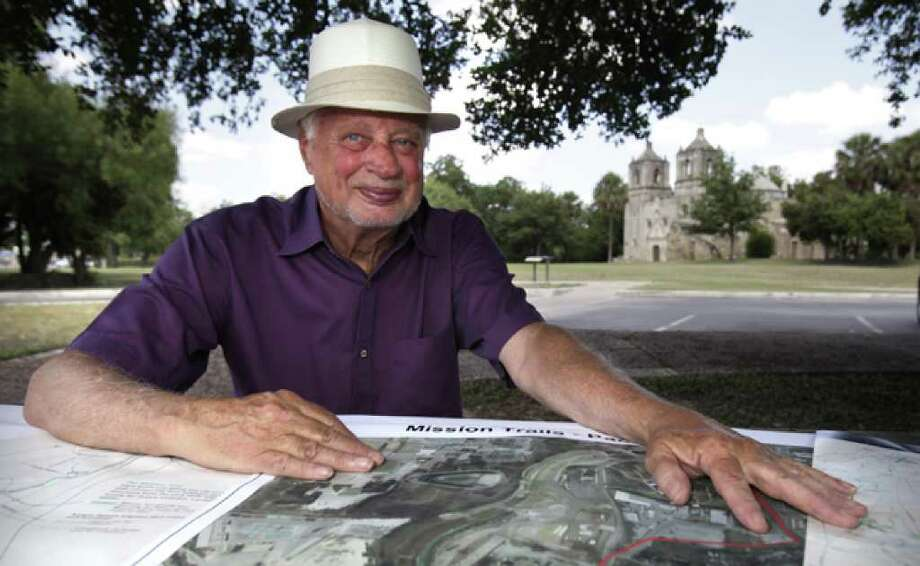 Milton Guess, seated in front of Mission Concepcion, said the project to link the Spanish colonial missions is a matter of economic development.