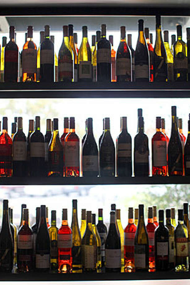 A diverse selection of wines decorates shelves in the windows at Auden's Kitchen. Auden's offers free wine sampling with free appetizers from 5:30 to 7:30 p.m. every Thursday. / spoecial to the San Antonio Express-News