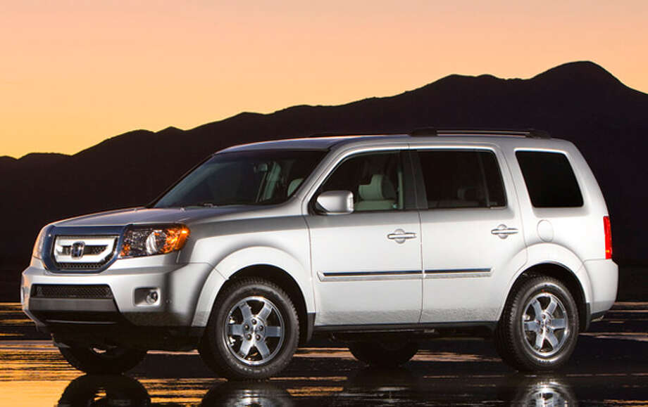 The five-door 2011 Honda Pilot has room for up to eight passengers and their luggage and is powered by a V-6 engine.