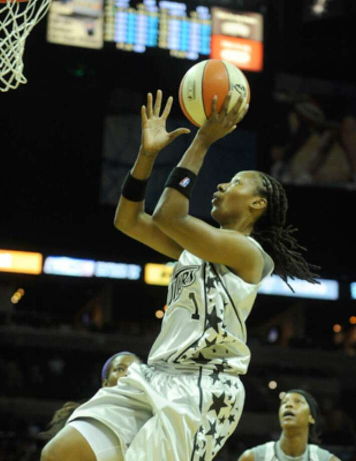 Chamique Holdsclaw, seen here scoring against the Los Angeles Sparks in May, will receive the 2009 Dawn Staley Community Leadership Award for her work with youth groups.