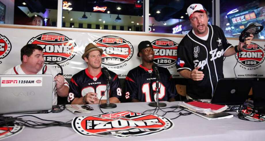 Radio personalities Jason Minnix (left) and Chris Duel (far right) serenade Houston Texans players David Anderson (left center) and Jacoby Jones (right center) Thursday.