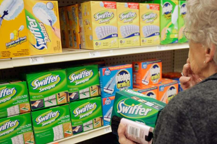 A shopper in Omaha, Neb., looks at Swiffer products in 2006. There's now a kit for just about every household cleaning task, from swabbing dust bunnies to scrubbing the toilet.