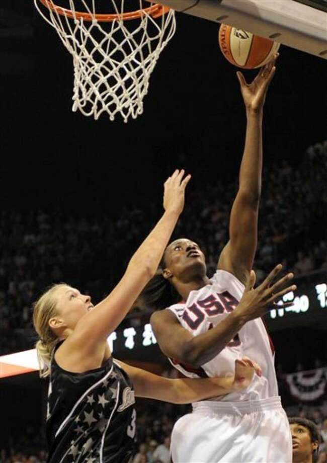 The Silver Stars' Jayne Appel (left) plays defense on Team USA's Sylvia Fowles during Saturday's USA vs. WNBA all-star game.