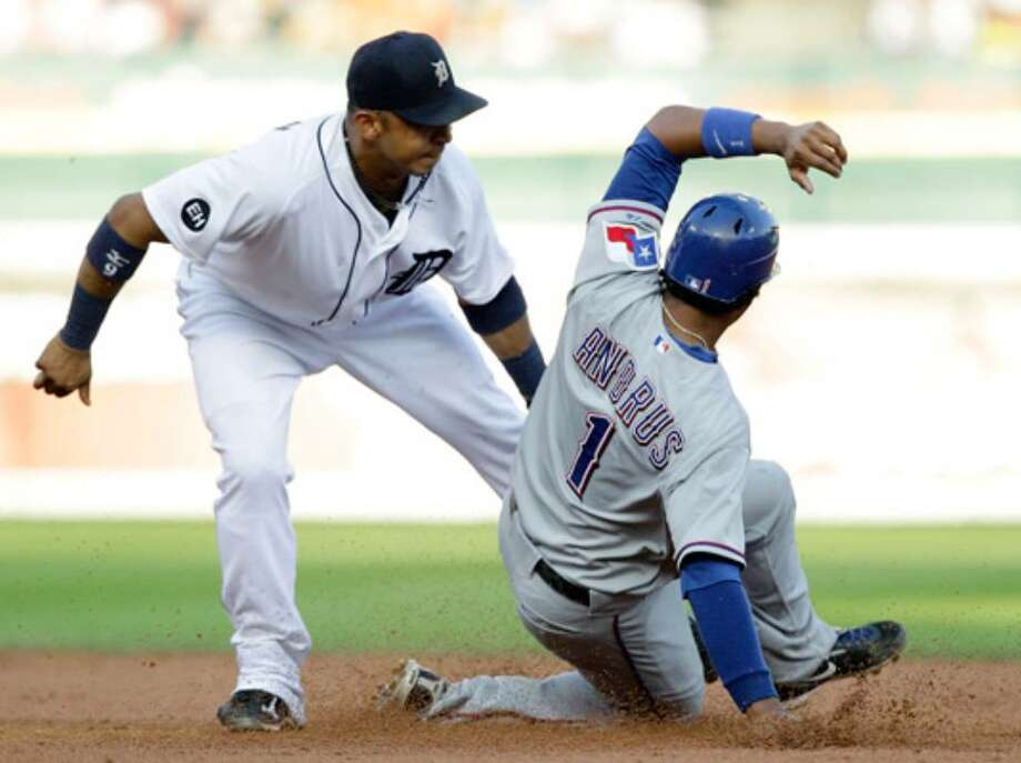 The Rangers' Elvis Andrus is tagged out by Detroit second baseman Carlos Guillen while trying to steal the base in the third inning.