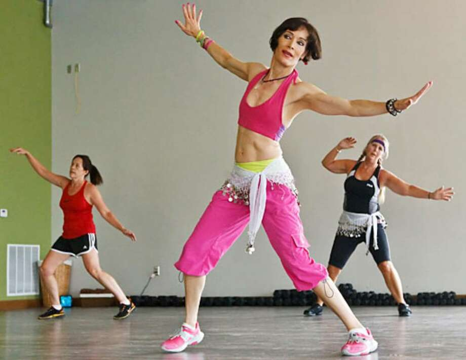 Jennifer Medeiros (center) leads a Zumba class at Studio 46 Fitness, 19851 Highway 46, Suite 201, on July 1, 2010. The studio will host it's grand opening on July 24.