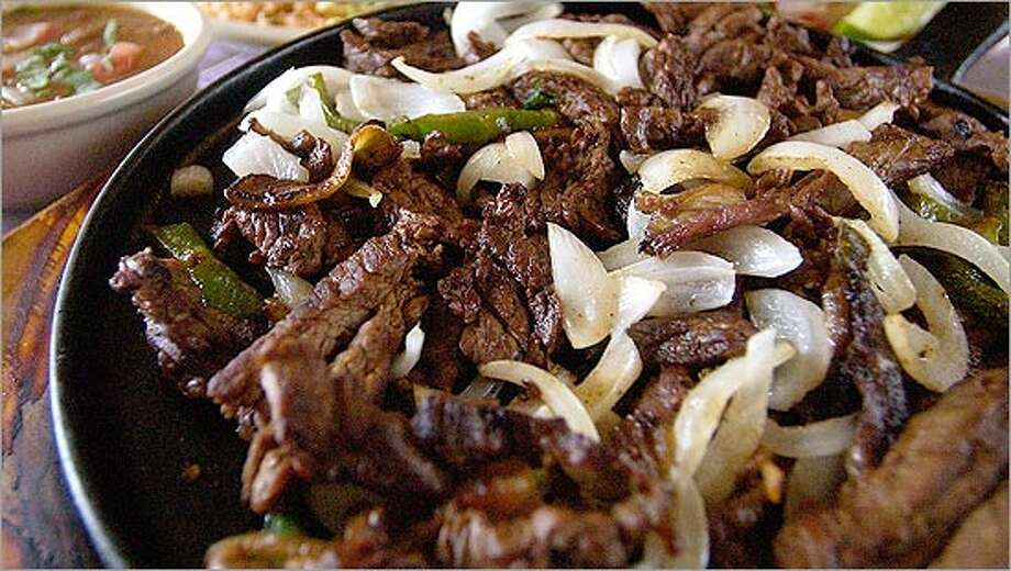 Fajitas are a favorite South Texas summer dish and best when they're fresh off the grill.