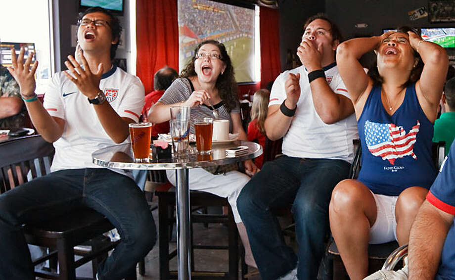 Soccer fans (from left) Allan Tejada, Deborah and Richi De Los Santos and Berto Arispe react to a close play in the United States vs. Slovenia FIFA World Cup game they watched Friday morning at Freetail Brewing Co., 4035 N Loop 1604 West. A packed and vocal house watched the game at Freetail. The U.S. team scored late to post a 2-2 draw. / Prime Time Newspapers 2010