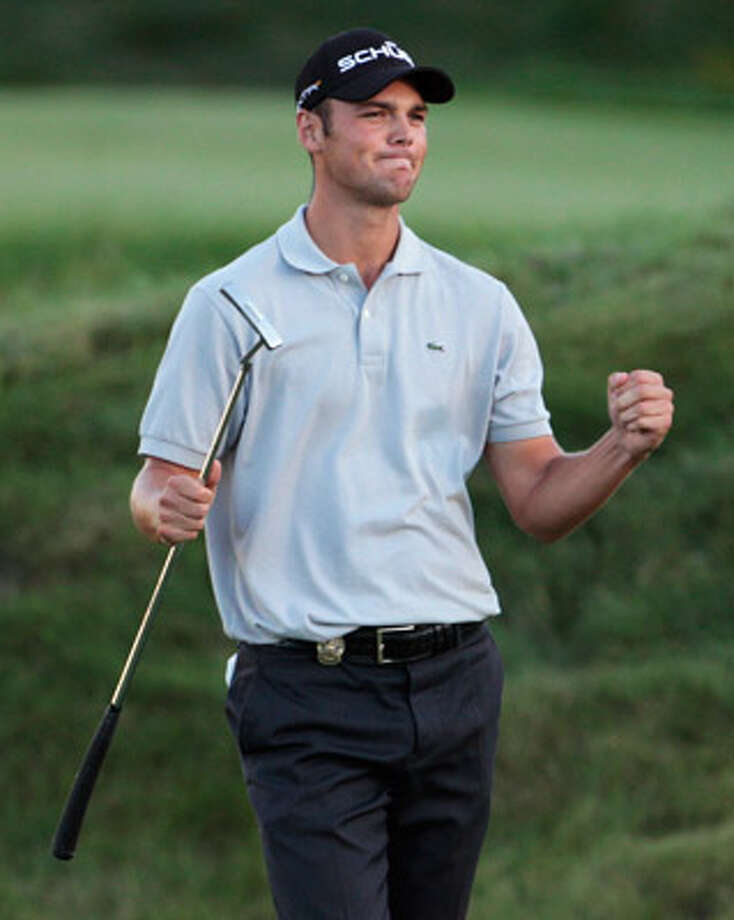 Martin Kaymer of Germany reacts after his tap-in bogey completed his PGA Championship playoff victory Sunday.