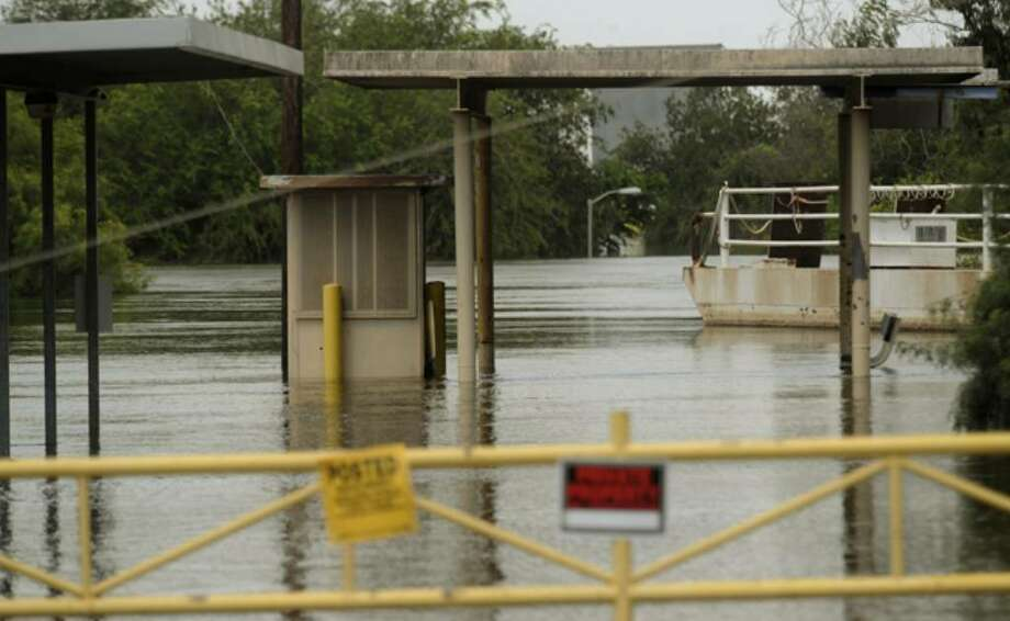 Among the problems it has caused, the high water coursing along the Rio Grande has closed the hand-operated ferry crossing at Los Ebanos.