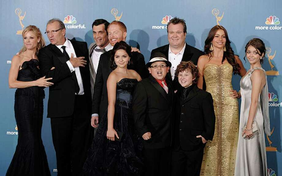 """Modern Family"" cast members pose in the press room after the ABC show won outstanding comedy series at the 62nd Primetime Emmy Awards Sunday in Los Angeles."