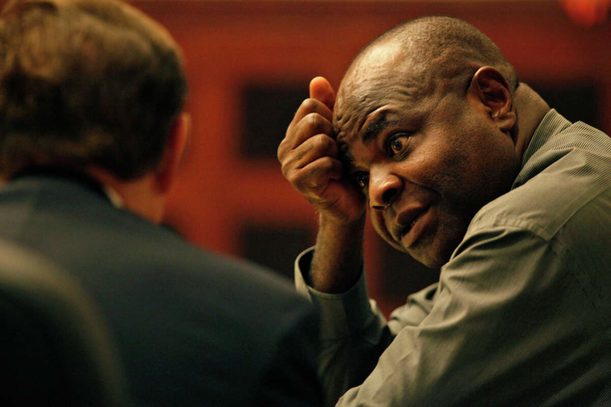 """Marcelleus J. Anunobi sits in the 227th district courtroom during a short recess. Anunobi, a dual citizen of the United States and Nigeria, opened Advanced Doctor's Prescribed Pharmacy on Medical Drive in 2007. He almost immediately began conducting higher-than-usual rates of business, Assistant District Attorney Charles Rich told jurors during opening statements. """"It's not a complicated scheme,"""" Rich said. """"It's arrogant, but it's not complicated. Mr. Anunobi ... billed Medicaid for drugs that were not prescribed ... and they were continually refilled."""" A jury found him guilty of defrauding the government of an estimated $2.5 million in false Medicaid bills."""