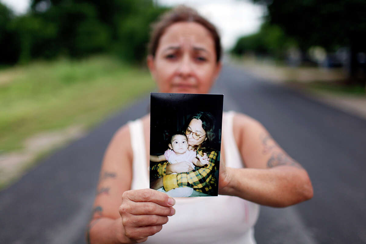Elizabeth Carmona holds a photo of her granddaughter Faith Escamilla. Faith's mother, Silver Starr Hernandez, was charged with capital murder Wednesday in her daughter's death.