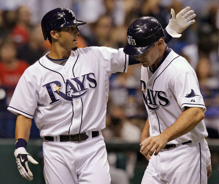 Tampa Bay?s Jason Bartlett (left) and John Jaso celebrate after scoring on a fourth-inning double by Evan Longoria.
