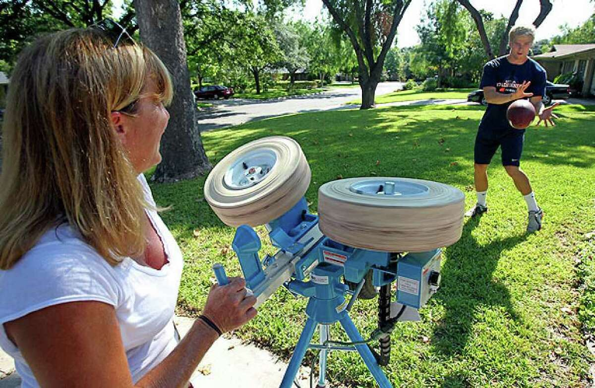 """UTSA receiver Jake Wanamaker trains with his mom, Kelly, on Wednesday, using the Jugs Field General. Kelly Wanamaker says the machine has """"been a gift to both of us."""""""