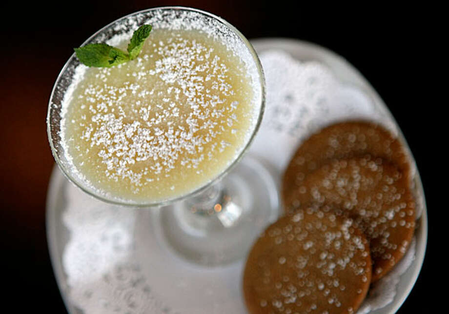 Picknikins Patio Caf?'s tangy Lemon Posset is served with crisp ginger cookies. / SAN ANTONIO EXPRESS-NEWS