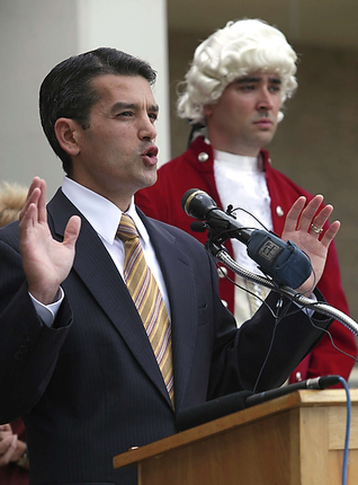 State Rep.Mike Villarreal gives a news conference to protest the proposed changes in the new social studies textbook guidelines. One of the new standards for social studies approved by the Texas State Board of Education that will appear in next fall's textbooks removes Thomas Jefferson, portrayed by an man at right, from a list of figures who inspired revolutions.
