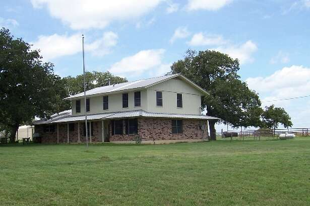 Two-story, 28-year-old home on 14 acres seven miles east of Floresville.