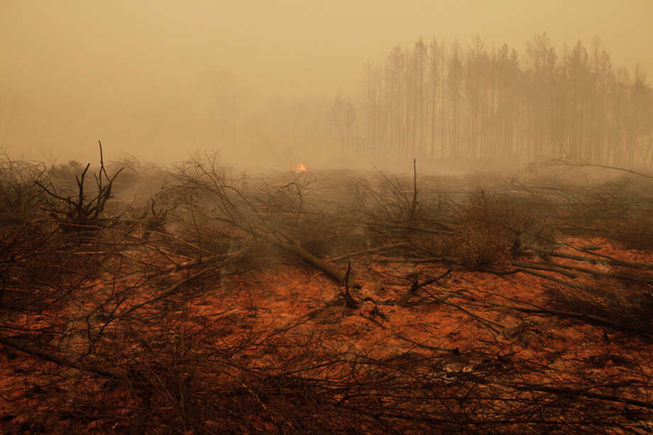 Some of the devastating wildfires sweeping western Russia are out of control, Russia's emergency chief said Tuesday, as fears grew there were not enough firefighters to battle them. / AP