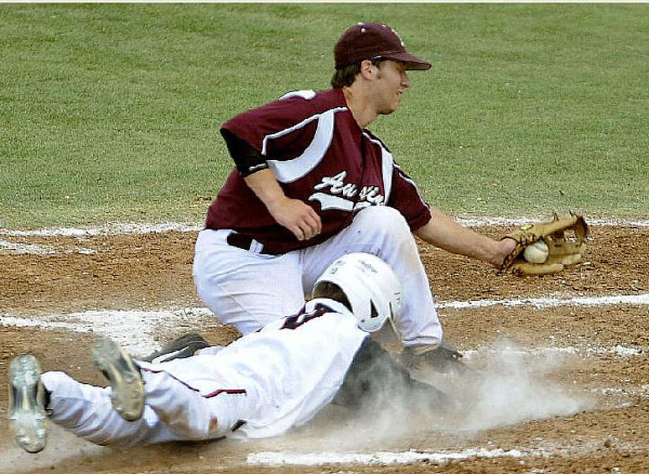 Churchill?s Matt Fewell slides in home under the tag of Austin High?s Allen Johnson during the Chargers? comeback victory.