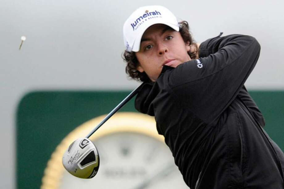 Northern Ireland's Rory McIlroy posted the first 63 in a first round at a British Open, assuming a two-stroke lead after Thursday's play on the Old Course at St. Andrews, Scotland. Because there was little wind in the morning, there were 45 rounds in the 60s.