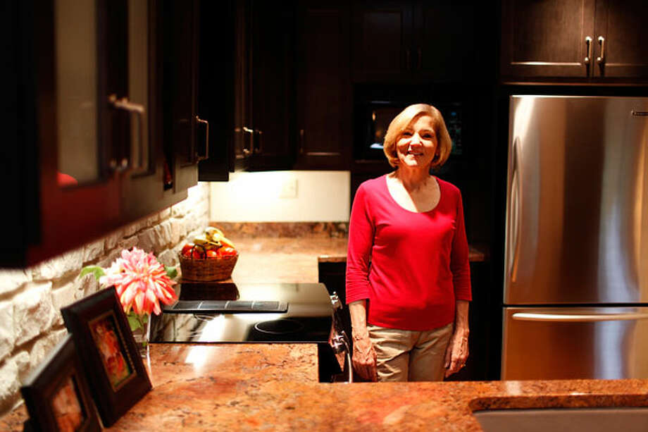 Cindy Rowe's relatively small kitchen suits her fine, especially after a recent update. The space features Bordeaux granite counters, a limestone rock wall and stained maple cabinets.