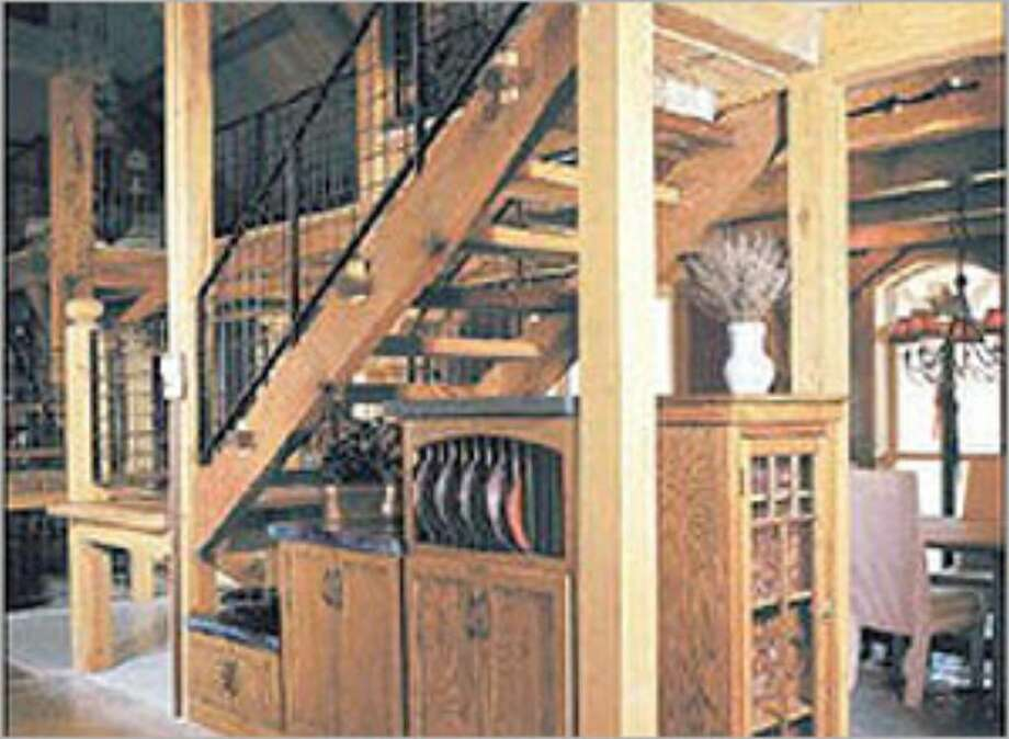 Under-stair storage is an attractive and smart utilization of space with built-in cabinets that easily hide bulk supplies purchased at big box stores.