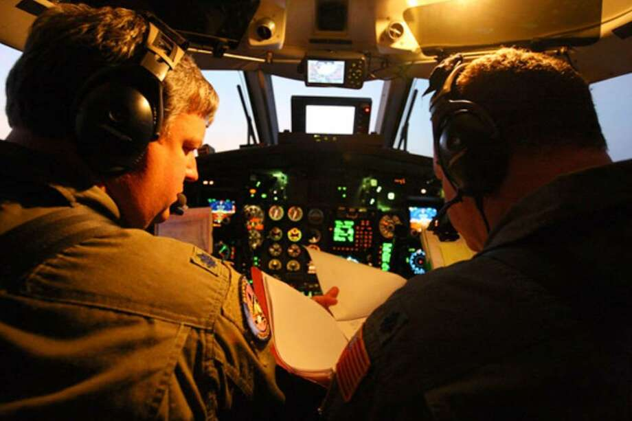 Lt. Col. Jay Hollis (left) and Lt. Col. Scott Craven, both of the 186th Air National Guard's Air Refueling Wing in Meridian, Miss., pilot an RC-26 aircraft in search of oil unleashed by the Deepwater Horizon rig disaster in the Gulf of Mexico.