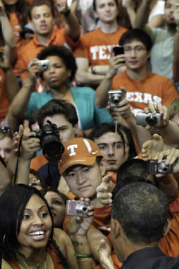 Students and supporters reach out to shake hands with President Obama after his speech Monday at the University of Texas in Austin.