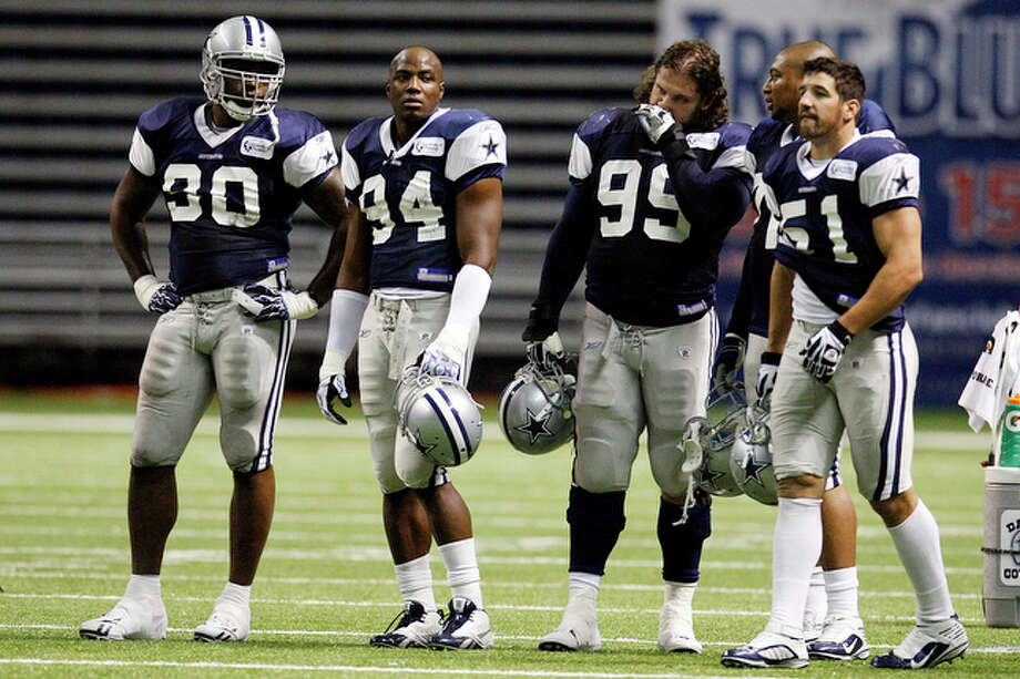 Dallas Cowboys nose tackle Jay Ratliff, left, and linebacker DeMarcus Ware, (94), during practice with, defensive end Igor Olshansky, (99), defensive end Stephen Bowen, (72) and linebacker Keith Brooking (51), at the Alamodome, Monday, August 2, 2010. The Cowboys will end their San Antonio camp this Friday. / glara@express-news.net