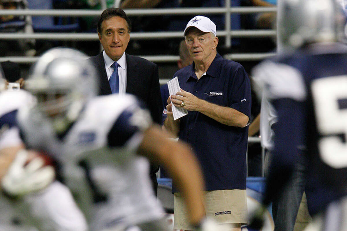 Cowboys owner Jerry Jones, right, talks with Henry Cisneros.
